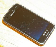 A cellphone with a lot of scratches
